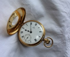 "An 18ct yellow gold Omega keyless wound half hunter pocket watch, with an enamel dial, Roman numerals and a seconds subsidiary dial, the exterior back plate with a coat of arms, the interior backplate inscribed ""Presented to W.Bro. Vincent J. O'Brien by his initiates as token of esteem and affection 1930-1931, 4.5cm diameter, approximately 102 grams. Sold for £1,050 at Anthemion Auctions"