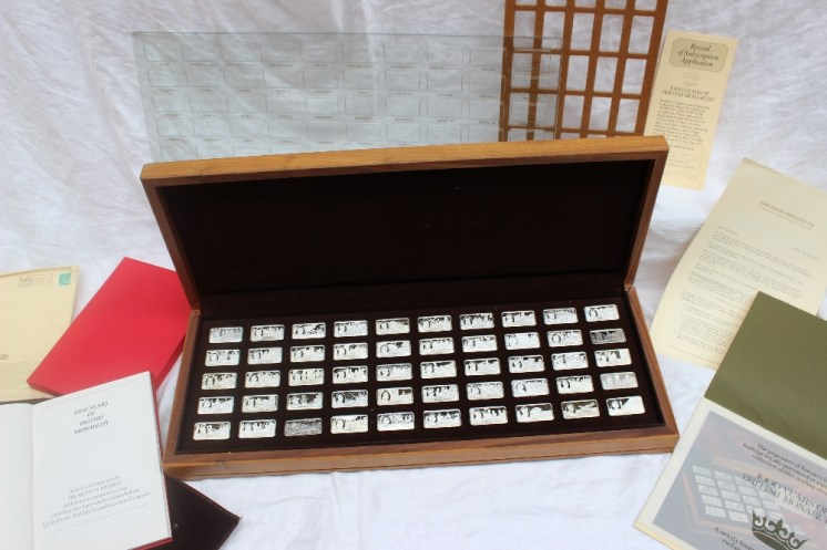 """A John Pinches set of fifty Sterling silver ingots for """"1000 years of British Monarchy"""", cased together with a copy of the historical commentary by Sir Arthur Bryant, published as a companion to the set. Sold for £980 at Anthemion Auctions"""