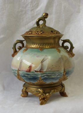 A Royal Worcester porcelain pot pourri vase and cover, the naturalistic finial above a domed top decorated with leaves and stars, the lobed globular body painted with sailing yachts on the open sea, signed by Raymond Rushton, on four leaf and twig feet, shape No. H241, green mark and date code for 1912, 22cms high. Sold for £420 at Anthemion Auctions