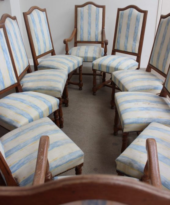 Anthemion Auctions Timed auction - Lot 1075. A set of ten 20th century oak dining chairs with pad seats and back on turned legs united by an H stretcher, includes two carvers