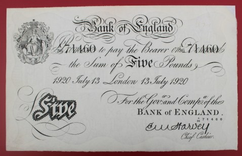 """A Bank of England white Five Pounds note, """"1920 July 13 London 13 July 1920"""" No. A36 71460, E.M Harvey chief cashier. Sold for £450 at Anthemion Auctions"""