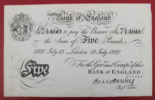 "A Bank of England white Five Pounds note, ""1920 July 13 London 13 July 1920"" No. A36 71460, E.M Harvey chief cashier. Sold for £450 at Anthemion Auctions"