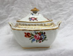 22nd August - Welsh Ceramics Lot 252. A 19th century Swansea porcelain twin handled sucrier and cover with a gilt pointed finial the body moulded with a basket weave and swags, painted with sprays of garden flowers, 16 cm wide, Sir Leslie Joseph Collection label to the base No.106 and Lady Shelley Rolls Collection label