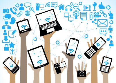 This picture showcases the various different technologies that are used daily including phones, laptops, computers etc.