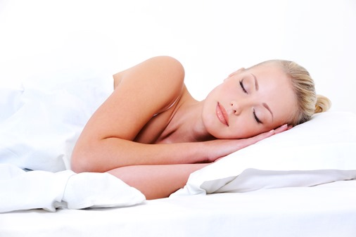 young sleeping woman seeing sweet dreams