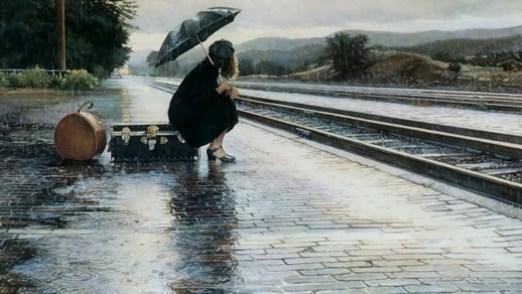 girlwomanrainumbrellatrainrailwaystationplatformsuitcase.jpg