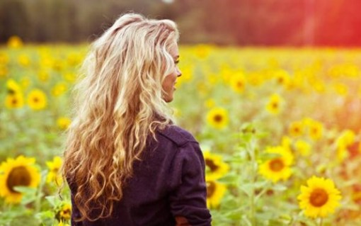 girl-smile-field-sunflowers