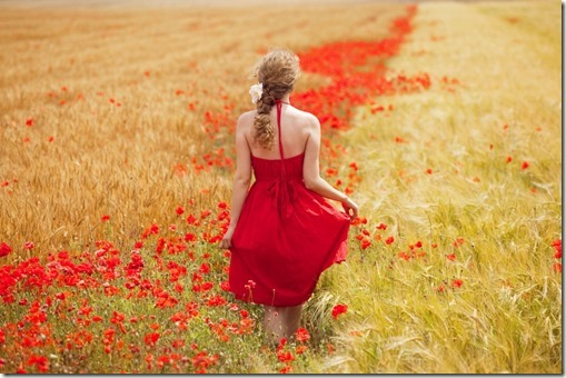 woman-walking-red-meadow-red-flowers