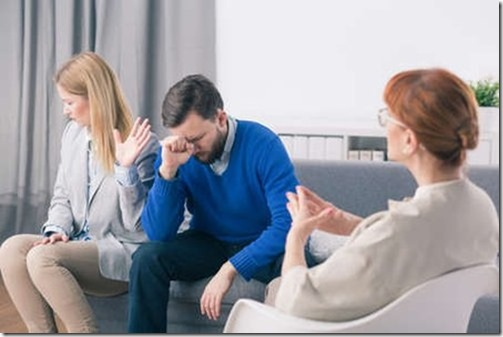 angry-wife-and-sad-husband-during-marriage-psychotherapy-with-counselor
