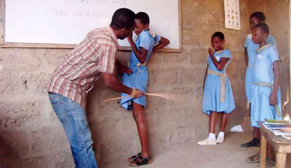 Nigerian kid been punished by a teacher