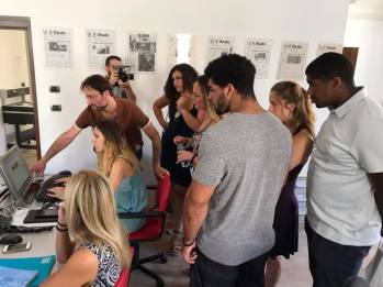 Students visit the newsroom of the journalism department at the University of Urbino.