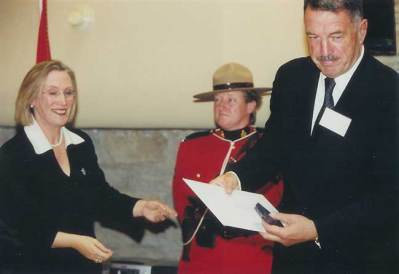 2002. Receiving the Queen's Golden Jubilee Medal, from the Secretary of State, Honorable Dr. Carolyn Bennet.