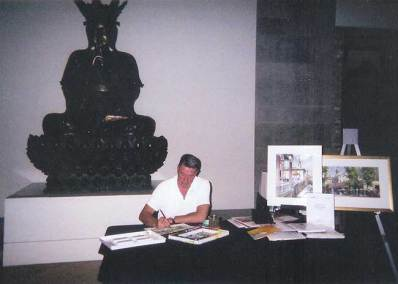 August, 2006. Registration Day at the Royal Ontario Museum.  Tony on the desk for his classes in watercolour techniques.