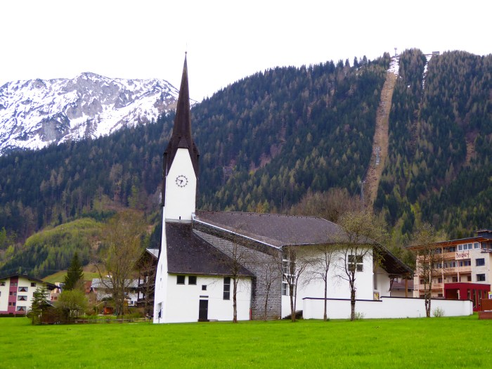 Pertisau Church with the ski lift showing as a brown streak down the mountain.
