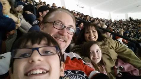 Having Fun At A Hockey Game with his Family