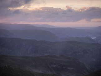 Ridges between Grisedale, Deepdale and Dovedale in the purple pink sunset after rain