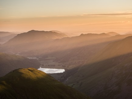 Sunrise seen from Red Screes looking down to Brothers Water