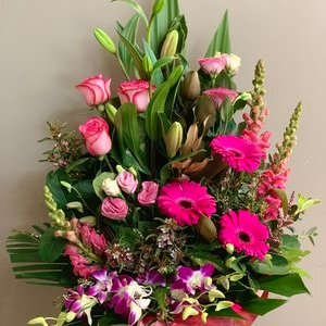 big flower arrangement in a floral box
