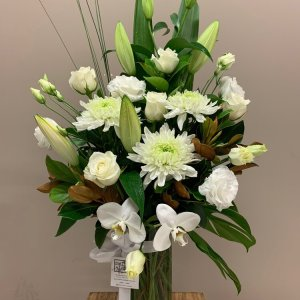 white assorted flowers in a vase