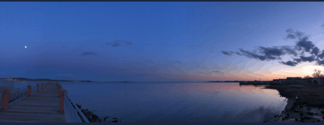 panoramic view of Long Island Sound at dusk (water with a shore at the right hand side of the image)