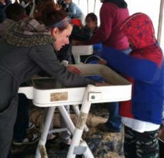 Dana Nyquist with Campus Archaeology and young archaeologist at Science Fest, via Katy Meyers