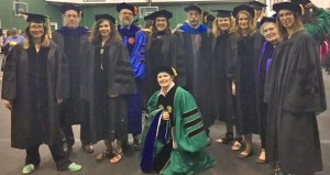 graduates and professors at graduation