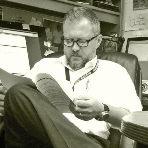 Dr. Joe Hefner reading an article