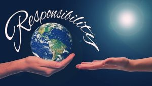 """Two hands holding a world with the word """"responsibility"""""""