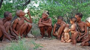 Group of hunter-gatherers sitting in a semicircle