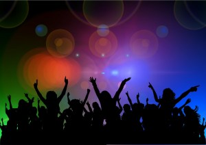 black silhouettes of people dancing with a multicolored background