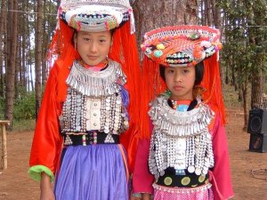 Two young indigenous girls wearing traditional clothing