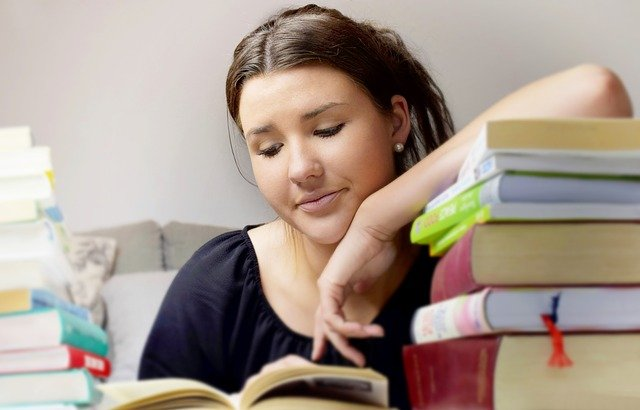 Instructor Alison.com Image of a woman reading a book.
