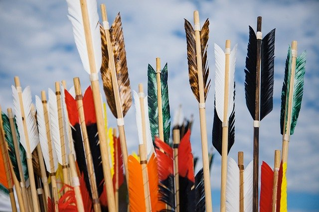 different colored feathers on arrows