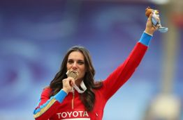 MOSCOW, RUSSIA - AUGUST 15: Gold medalist Elena Isinbaeva of Russia poses on the podium during the medal ceremony for the Women's Pole Vault during Day Six of the 14th IAAF World Athletics Championships Moscow 2013 at Luzhniki Stadium on August 15, 2013 in Moscow, Russia. (Photo by Julian Finney/Getty Images)