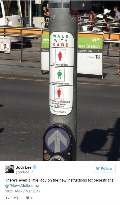 Female pedestrian crossing lights