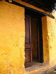 Yellow Wall and Wooden Doorway in Antigua
