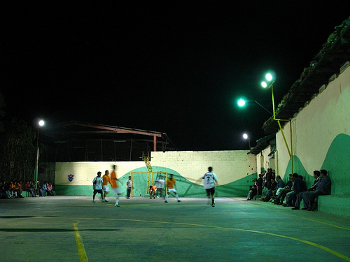 Playing Football at the Local Basketball Court