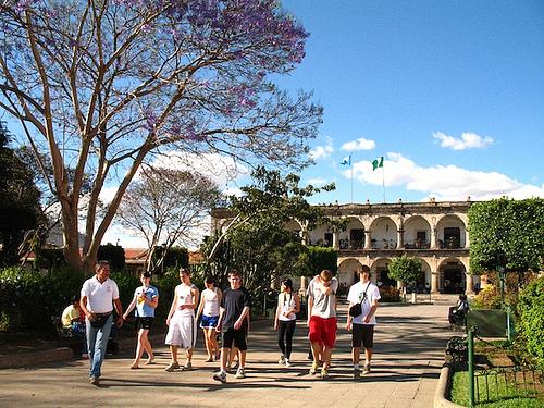 Tourists Enjoying A Stroll Around Antigua