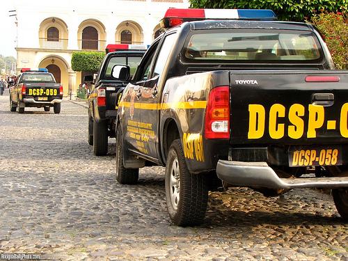Guatemalan Police Patrol Trucks by a Rudy Girón
