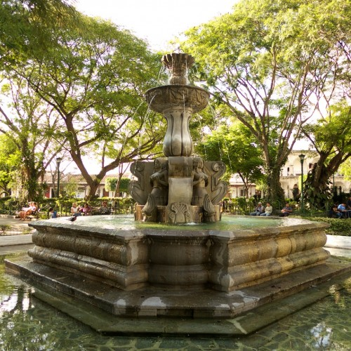 Tranquility at Parque Central of Antigua Guatemala by Rudy Girón