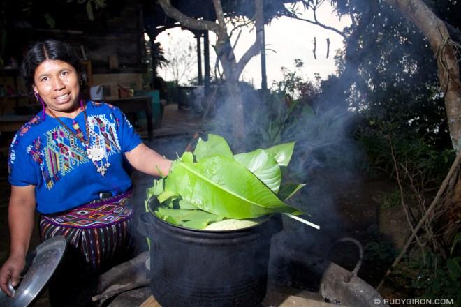 Rudy Giron: Antigua Guatemala &emdash; Maya woman cooking corn on the cub
