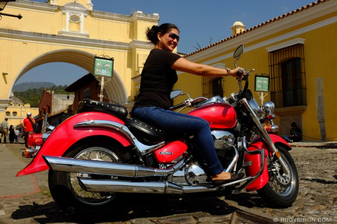 Rudy Giron: Antigua Guatemala &emdash; Red motorcycle on Calle del Arco