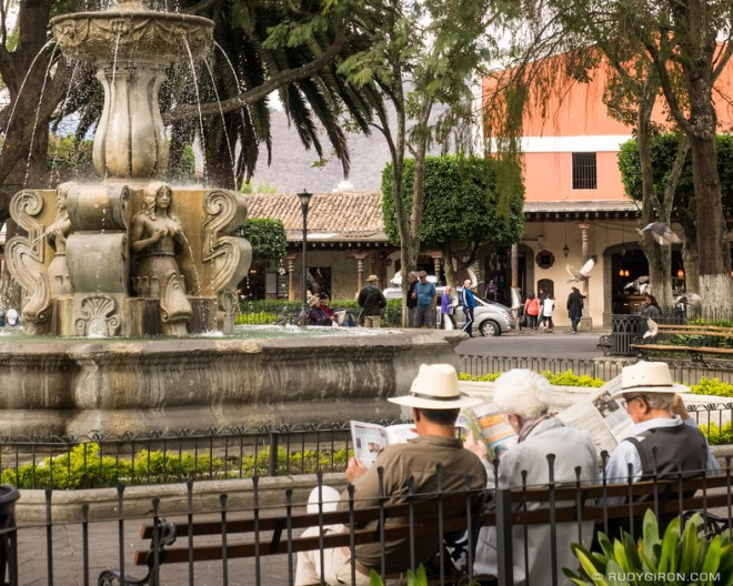 Rudy Giron: Antigua Guatemala &emdash; Catching up with the newspapers at Parque Central of Antigua Guatemala