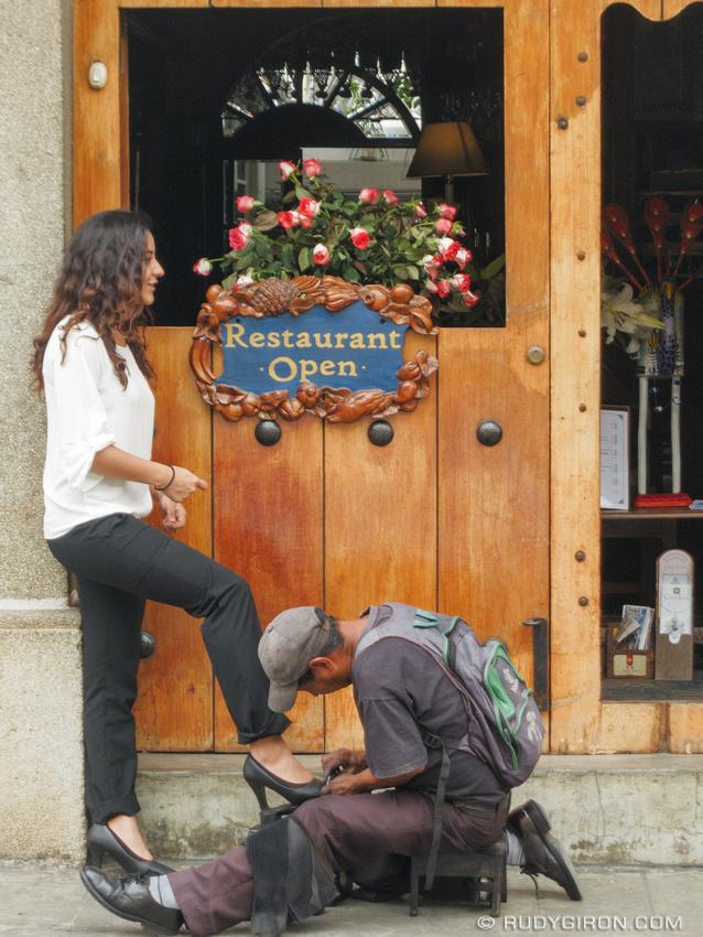 Rudy Giron: Antigua Guatemala &emdash; Woman having her shoes shone in Antigua Guatemala