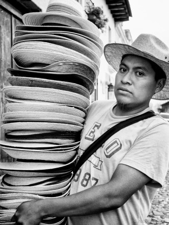 Portrait of an Ambulant Sombrero Vendor by Rudy Giron