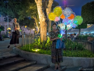 Street Photography — Two Women Worlds Apart at Parque Central of Antigua Guatemala BY RUDY GIRON