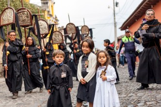 Kids posing during a procession in Antigua Guatemala BY RUDY GIRON