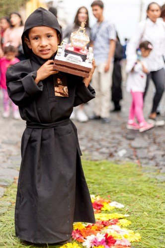 Little boy carrying a processional float in Antigua Guatemala BY RUDY GIRON