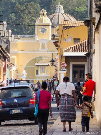 Quotidian Vistas of Antigua Guatemala: Morning traffic at Calle del Arco by Rudy Giron