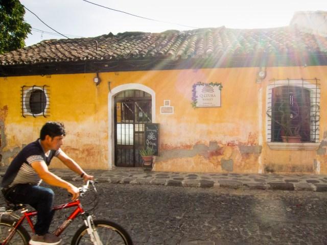 Bicycle rider in Antigua Guatemala BY RUDY GIRON